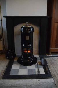 Het kolenkacheltje waarmee ik mijn hele huis kan verwarmen